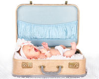 Baby yawning in a suitcase Royalty Free Stock Photos