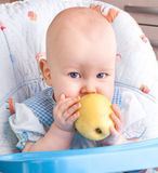 Baby with yellow apple Stock Photos