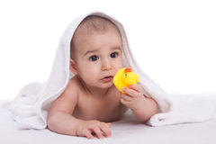 Baby with yellow duck isolated on white Stock Photography