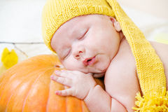 Baby in yellow hat Stock Image