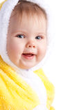 Baby in yellow hood Stock Photos
