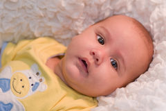 Baby with yellow shirt Royalty Free Stock Photography