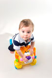 Baby with yellow wheel toy stock images