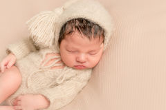 Baby in a yellowish outfit, sleeping Stock Photos