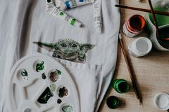 Baby Yoda from new Disney Star War TV series Mandalorian drawing on fabric with acrylic paints. Fan art. Kropivnitskiy, Ukraine,