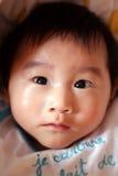 babyansikte arkivfoto