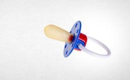 Babyattrappe oder blindes Silikon des Babys auf einem Hintergrund Stockfotografie