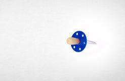 Babyattrappe oder blindes Silikon des Babys auf einem Hintergrund Lizenzfreie Stockfotos