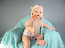 Babybiss der orange Löffel Lizenzfreie Stockfotografie