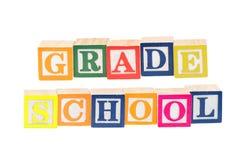 Babyblokken die lage school spellen Stock Foto