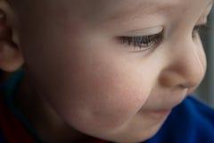 Babyboy画象面颊微笑 免版税库存图片