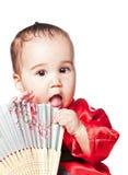 Babyboy asiático em um quimono vermelho Fotografia de Stock Royalty Free