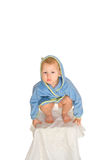 Babyboy in a dressing gown sits on a chair Stock Photo