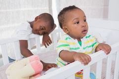 Babyboy and his brother in babyroom Royalty Free Stock Photo