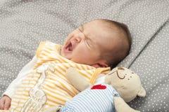 Babyboy newborn yawning Stock Photos
