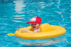 Babyboy in the pool Stock Images