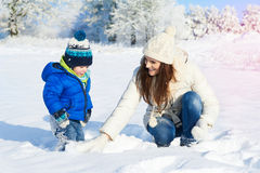 Babyboy son and mother are happy together - winter day Stock Image