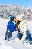 Babyboy son and mother are happy together - winter day Royalty Free Stock Image