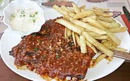 Babybucks ribs with garlic sauce Stock Images