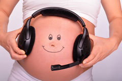 Babybuik met een hoofdtelefoon Royalty-vrije Stock Fotografie