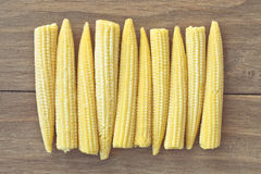 Babycorn. Pieces of fresh babycorn on a wooden surface Royalty Free Stock Images