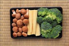 Babycorn y bróculi de la seta en paquete Imagen de archivo libre de regalías