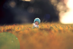 Babydoll. On winter grass with dress stock photos