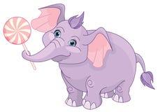 Babyelefant mit rosa Lutscher Lizenzfreie Stockfotografie
