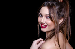 Babyface female model wearing strapless white dress on black background Stock Photo