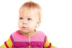 Babygirl. Beautiful babygirl in colorful jacket on white background Stock Images