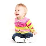 Babygirl. Beautiful babygirl in colorful jacket on white background Royalty Free Stock Image