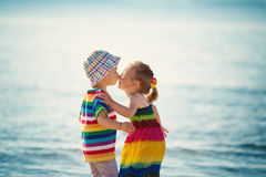 Babygirl and babyboy kissing on the beach Stock Images
