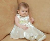 Babygirl en ropa del día de fiesta Imagen de archivo