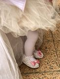 Babygirl on her first birthday party with tulle skirt and slippers royalty free stock image