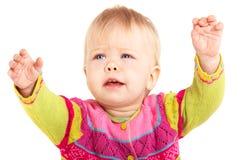 Babygirl isolated. Beautiful babygirl in colorful jacket on white background Royalty Free Stock Photo
