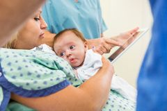 Babygirl With Loving Mother In Hospital. Cute newborn babygirl with loving mother in hospital Royalty Free Stock Photo