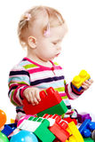 Babygirl playing with blocks. Babygirl playing with colorful blocks on white background Stock Photography