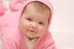 Babygirl in rose hood. Portrait of newborn baby in rose hood Stock Image