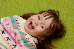 Babygirl smiling at camera Royalty Free Stock Photo