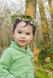 Babygril with flowers crown on head. In forest Royalty Free Stock Images