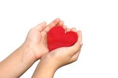 Babyhand en hart Royalty-vrije Stock Afbeelding