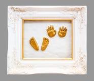 Babyhand und -abdruck Stockfotos