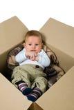 Babyjongen in de doos Royalty-vrije Stock Foto's