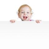 Babyjongen die leeg aanplakbiljet met exemplaarruimte tonen Royalty-vrije Stock Afbeelding