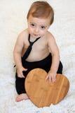 Babyjongen met hart Stock Foto's
