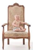 Babyjongen op een antieke stoel Royalty-vrije Stock Foto's