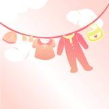 Babykleidungskarte Stockfotografie