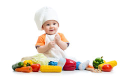 Babykoch mit Gemüse lizenzfreie stockfotos