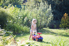 Babyl plays with car Royalty Free Stock Photography