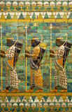 Babylonian Archers. These men with bows and spears are depicted at the Ishtar Gate, one of the gates to ancient Babylon. The base relief was reconstructed at stock image